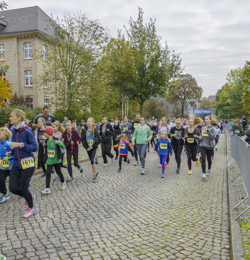 Mother and daughter, young girls, children are running Sport holiday, marathon in Germany, Magdeburg, oktober 2015. Mother and daughter, young girls, children stock photography