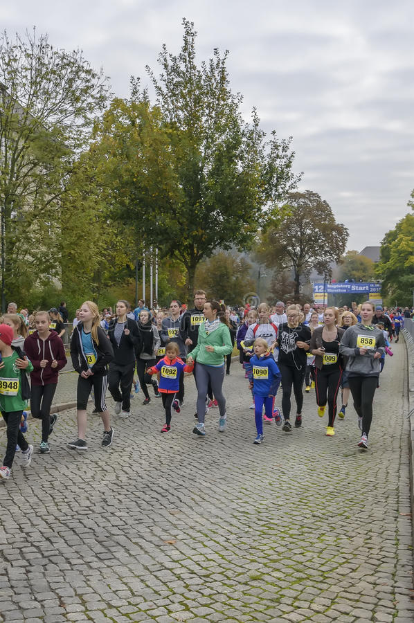 Mother and daughter, young girls running Sport holiday, marathon in Germany, Magdeburg, oktober 2015. Mother and daughter, young girls are running distance of 4 royalty free stock photos