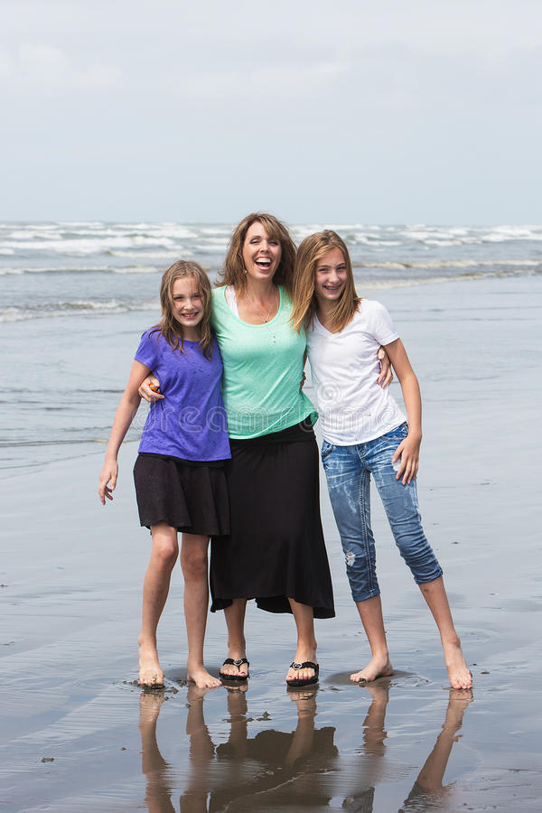 Mother and Daughters at the Beach stock images