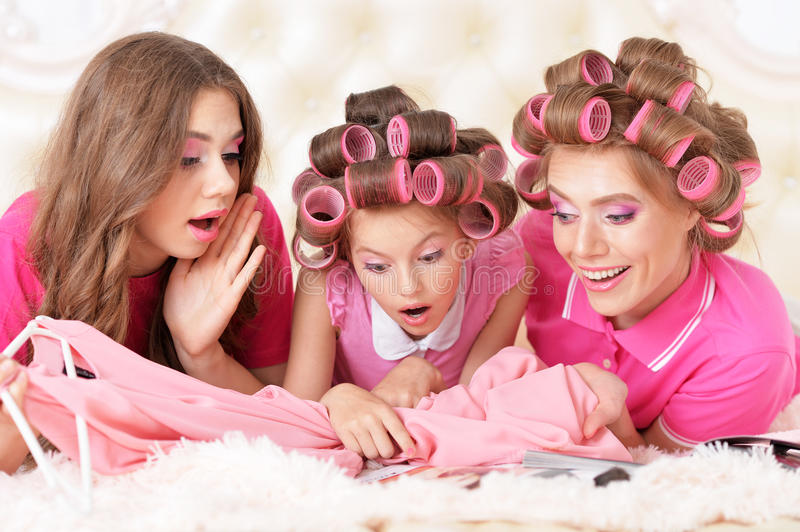 Mother and daughters in hair curlers stock image