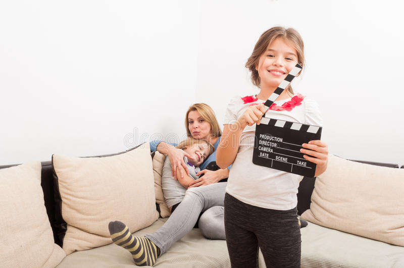 Mother and daughters having fun at home on the couch royalty free stock images