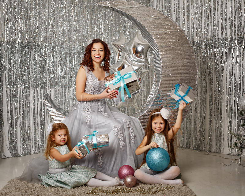 Mother and daughters. Merry Christmas. royalty free stock image
