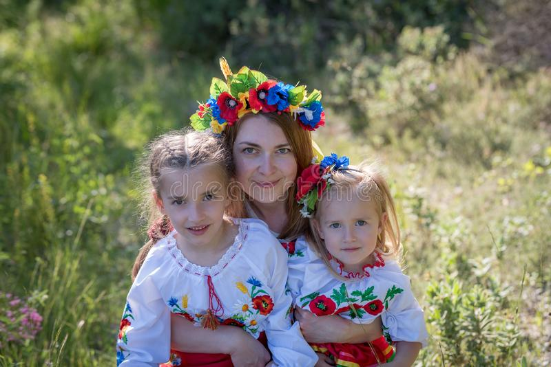 Mother and daughters in Ukrainian national dress royalty free stock images
