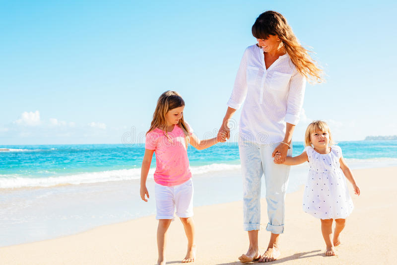 Mother daughters walking on the beach stock photos