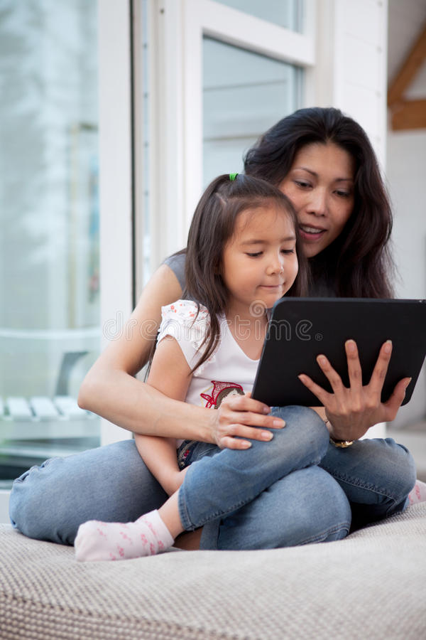 Mother and Daugther with Digital Tablet stock image