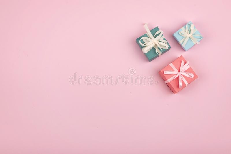 Mother day, Festive, birthday, Gift pastel minimal background. Multicolored Gift boxes on pink background. Gift, present concept royalty free stock image
