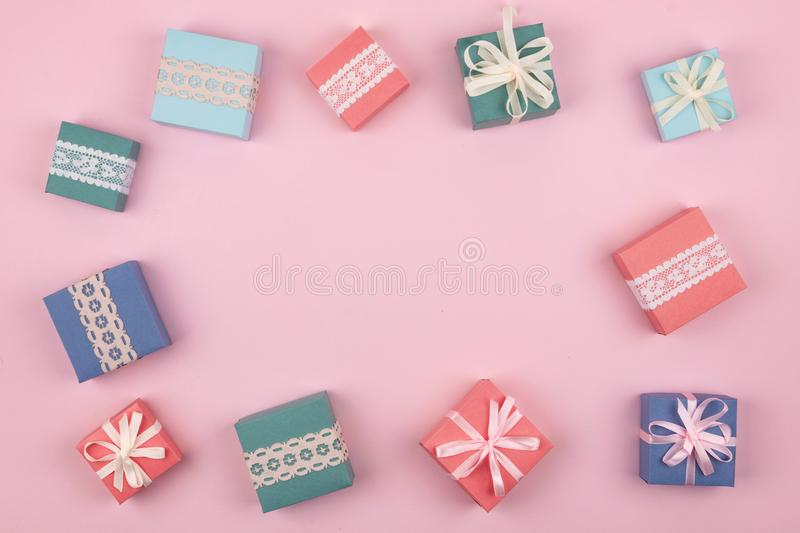 Mother day, Festive, birthday, Gift pastel minimal background. Multicolored Gift boxes on pink background. Gift, present concept stock photos