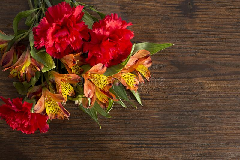 Mother day. Flower bouqet in a wood backgroud stock photo