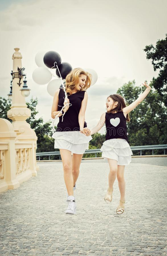 Mother with doughter having a fun with baloons royalty free stock images