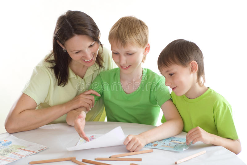 Mother draws with his sons royalty free stock images