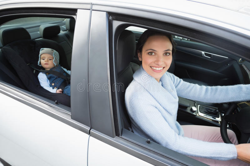mother driving with her baby in the car seat stock photo image 49212069. Black Bedroom Furniture Sets. Home Design Ideas