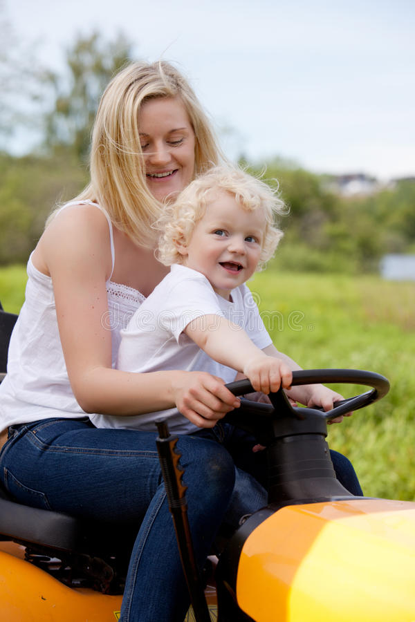 Mother Driving Tractor with Son stock photography