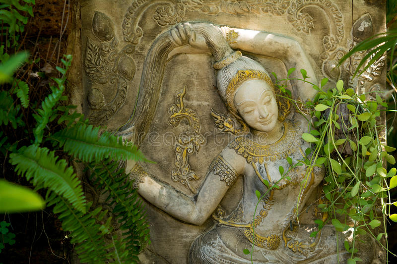 Mother Earth statue. In the garden. It is a decoration staff which is beautiful and peace stock image