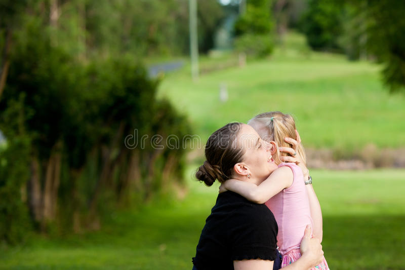 A Mother Embraces Her Daughter Outdoors Stock Photography