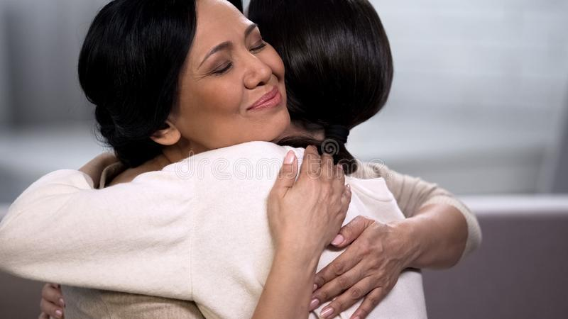 Mother embracing young daughter, empathy and tenderness, love and maternity. Stock photo stock photos