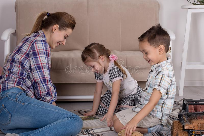 Mother is engaged with children. Mother with small children read. Books royalty free stock photo