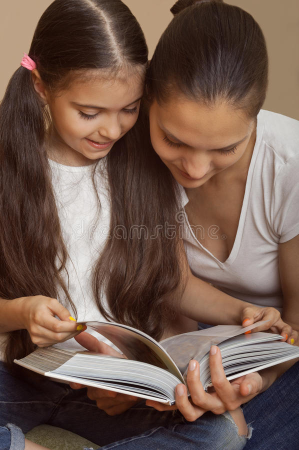 Mother explains to the daughter a lesson stock photos