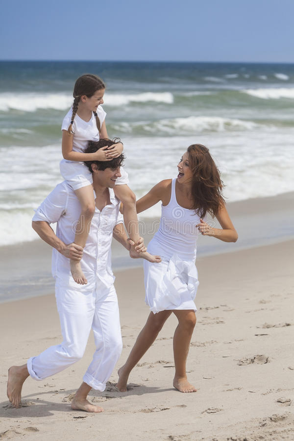 Download Mother, Father & Child Family Playing At Beach Stock Image - Image: 26053075
