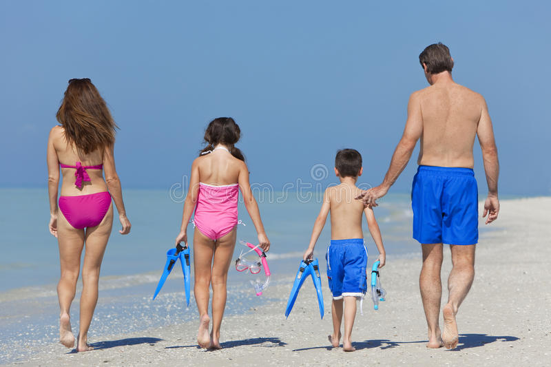 Download Mother, Father & Children Family Walking On Beach Stock Photo - Image: 23095048