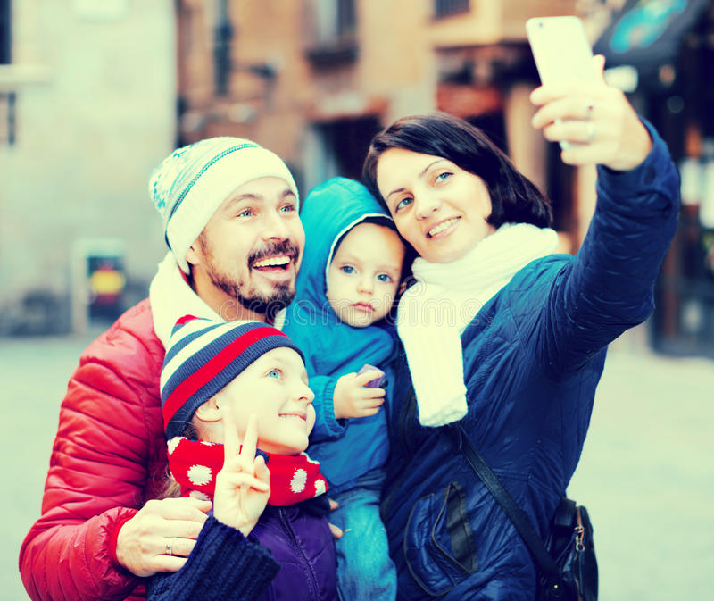 Mother and father with children making selfie royalty free stock images