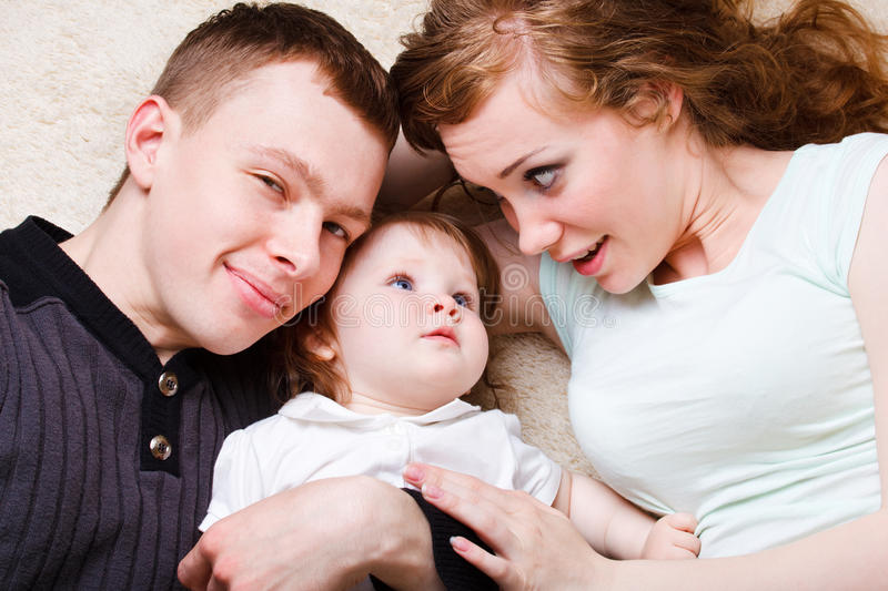 Mother, father and daughter stock image