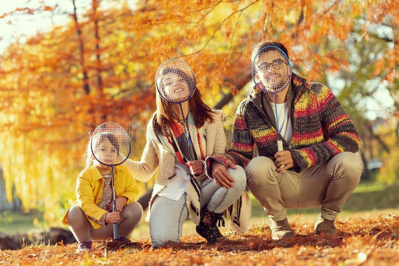 Family playing badminton royalty free stock photography