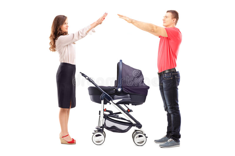 Download Mother And Father Gesturing With Their Hands Protection Above A Stock Photo - Image of perambulator, female: 31761246