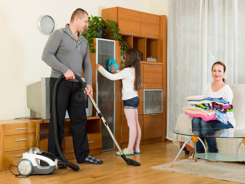 Mother, father and girl doing general cleaning royalty free stock image