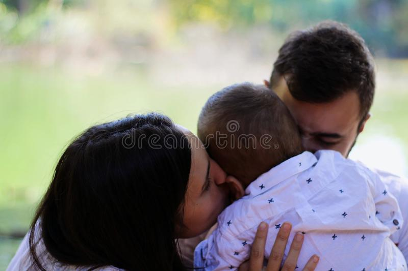 Mother and Father with his little cute son having fun outdoors in a park during autumn stock photography