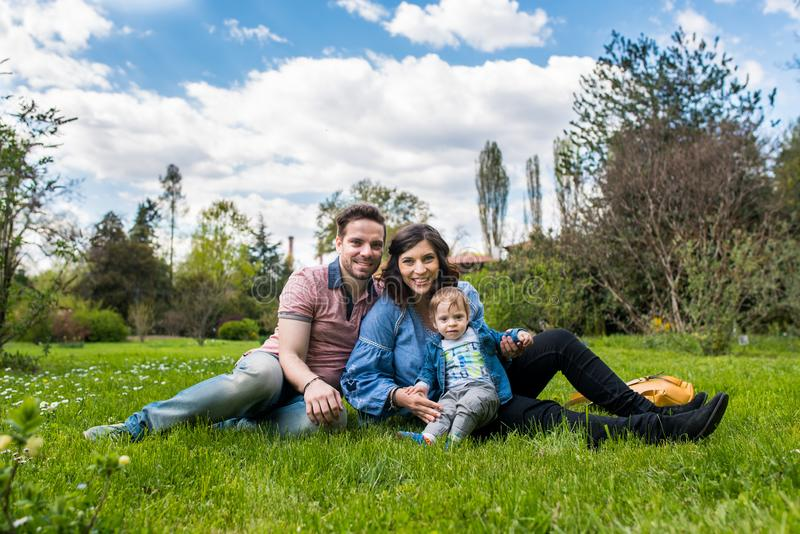 Happy loving family. mother father and child in the park stock photo