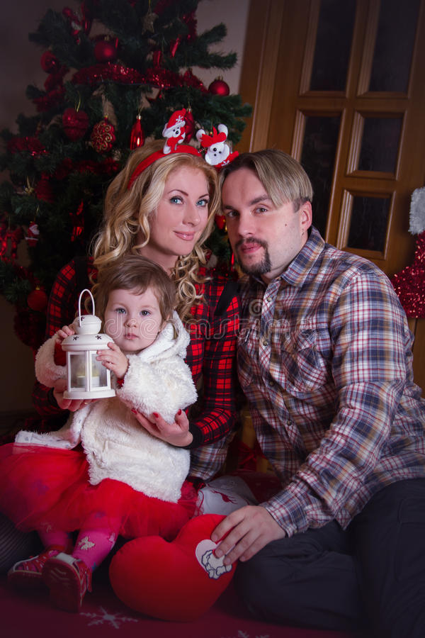 Mother and father with little baby girl at Christmas royalty free stock photos