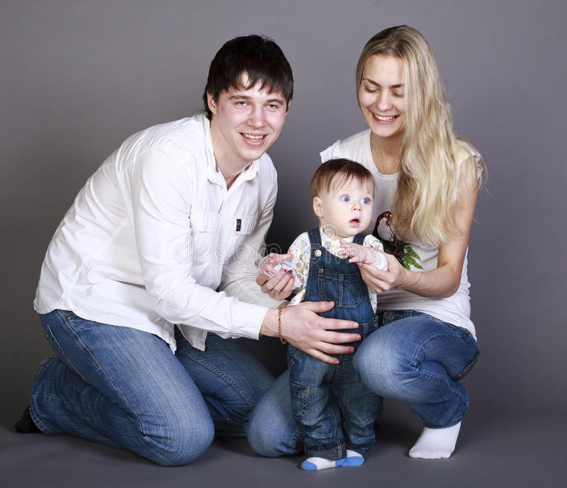 mother, father and little girl. stock photos