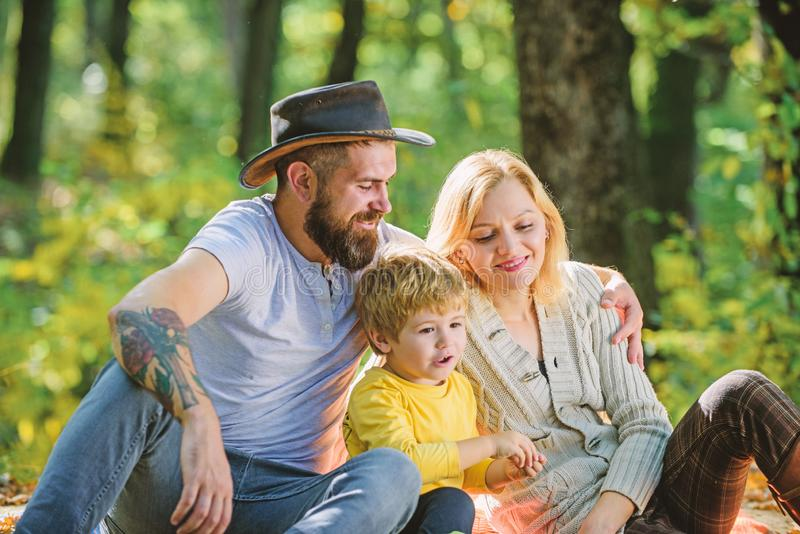 Mother father and little son sit forest picnic. Good day for spring picnic in nature. Explore nature together. Family royalty free stock photos