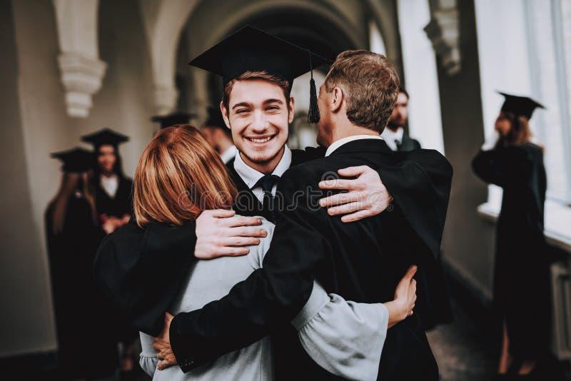 Mother. Father. Son. Hugs. University. Graduates. stock images