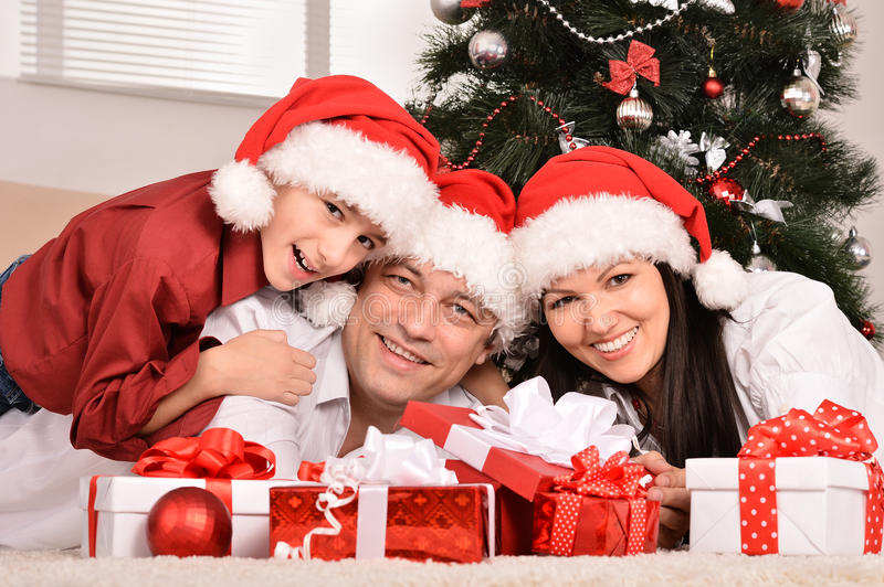Mother father and son near christmas tree stock image