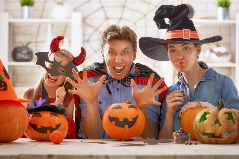Family celebrating Halloween stock photos
