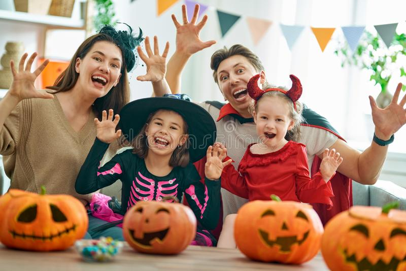 Family preparing for Halloween royalty free stock photos
