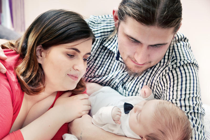 Mother and father with their young baby stock photo