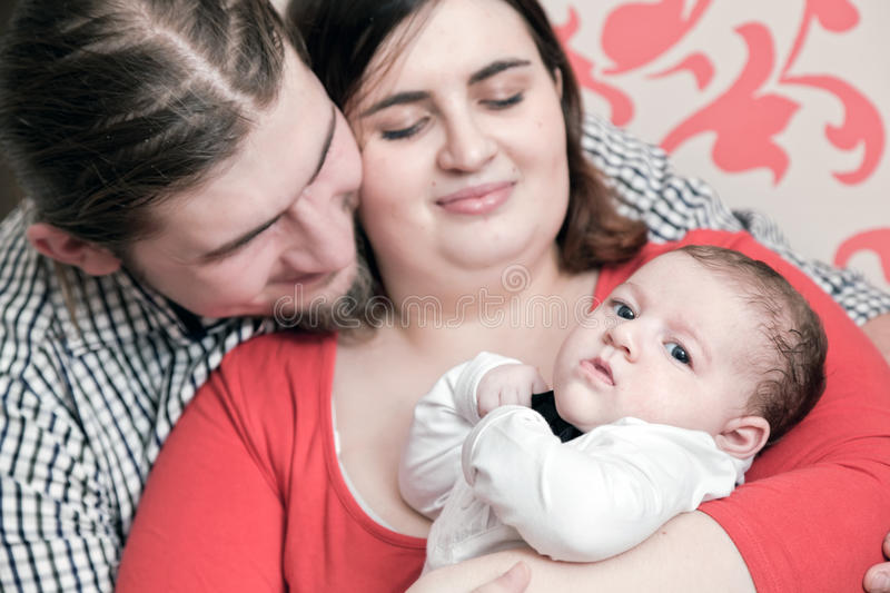 Mother and father with their young baby stock photos