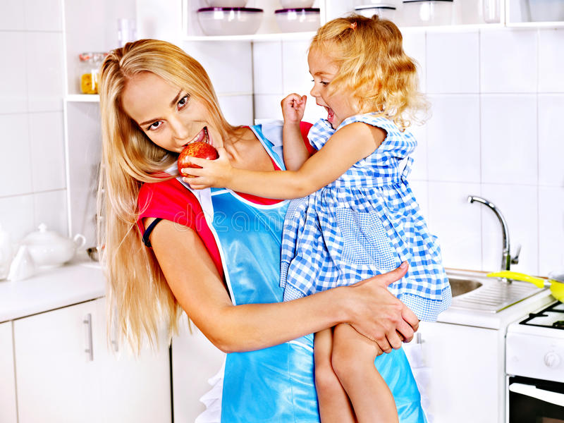 Download Mother  Feed Child At Kitchen. Stock Image - Image: 34070771
