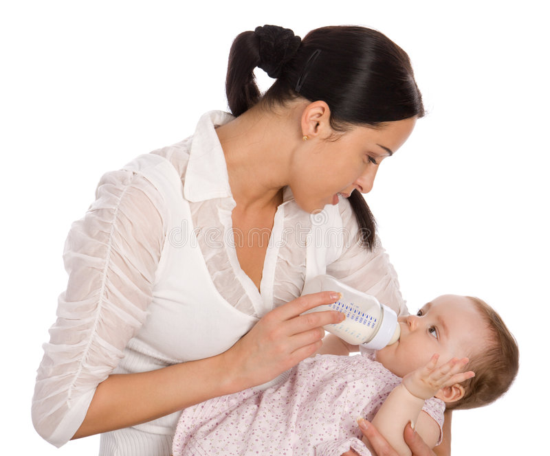 Mother feeding baby daughter stock image