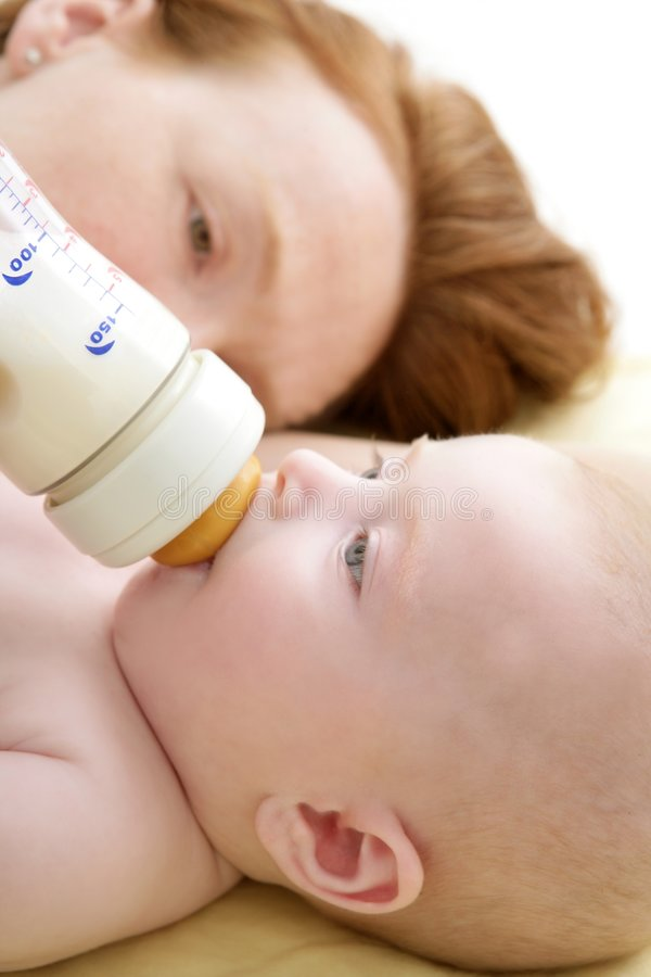 Download Mother Feeding Giving A Milk Bottle To Her  Baby Stock Photo - Image: 9185252