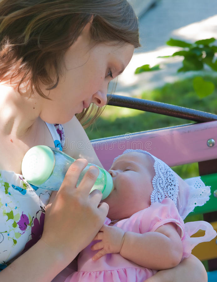 Download Mother feeding her baby stock photo. Image of cheerful - 14862262