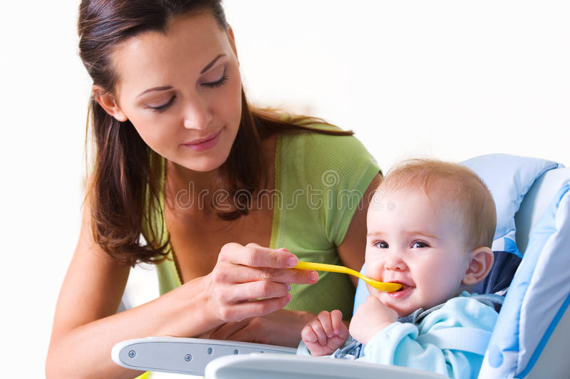 Download Mother feeding hungry baby stock image. Image of cheerful - 18130081