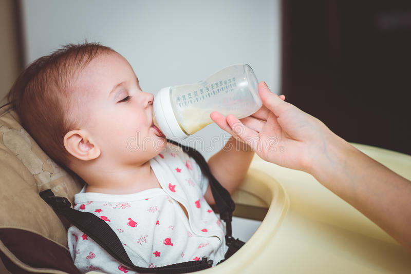 Download Mother Feeds Baby From A Bottle Of Milk Stock Photo - Image: 83718778