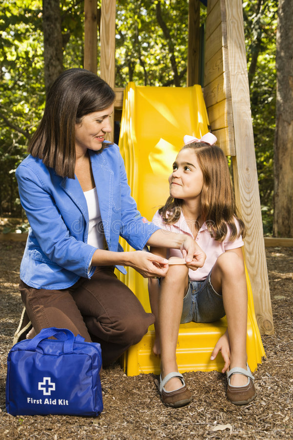 Download Mother with first aid. stock photo. Image of first, expression - 4246780