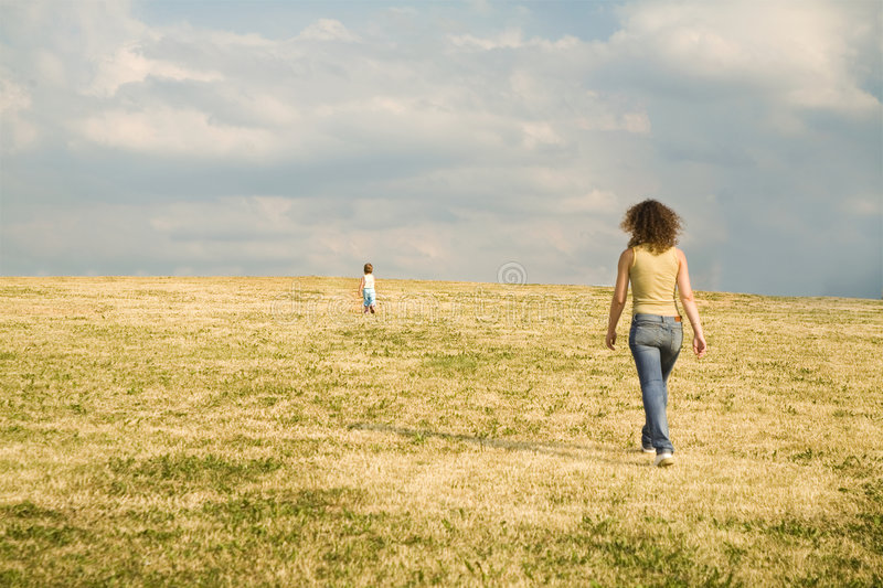 Mother following child. Run to the future behind the children royalty free stock photos