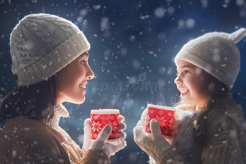 Mother and girl drinking tea stock image
