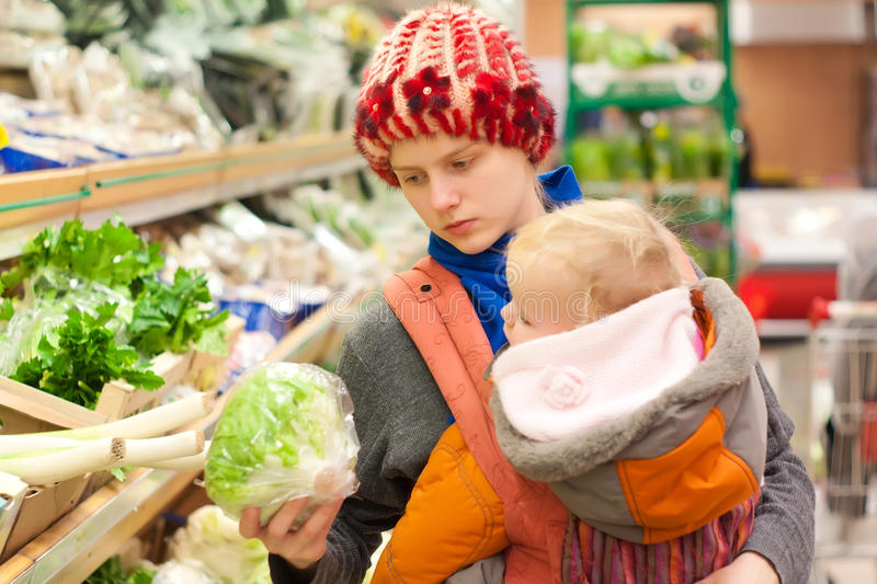 Download Mother With Girl Shopping In Supermarket Stock Photo - Image of market, happy: 16975074