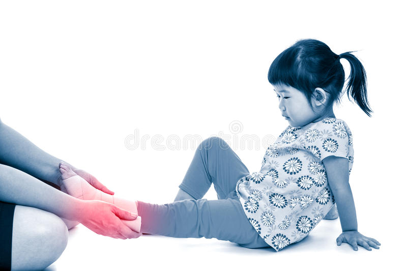 Mother give first aid at ankle trauma. Isolated on white background. Caring nurse bandage asian girl`s ankle. Mother give first aid at ankle trauma. Isolated on stock photography